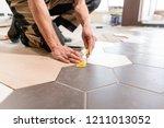 male worker makes measurements... | Shutterstock . vector #1211013052
