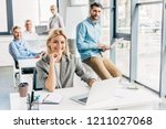 young start up team smiling at... | Shutterstock . vector #1211027068