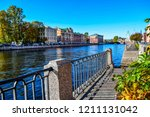 autumn city river embankment...   Shutterstock . vector #1211131042