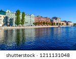 city river houses panorama in... | Shutterstock . vector #1211131048