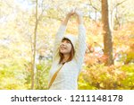 smiling asian woman | Shutterstock . vector #1211148178