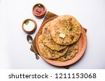 aloo paratha   indian potato... | Shutterstock . vector #1211153068