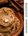 aloo paratha   indian potato... | Shutterstock . vector #1211153218