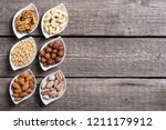 mix of nuts   pistachios ... | Shutterstock . vector #1211179912