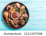 grilled chicken legs with... | Shutterstock . vector #1211197438