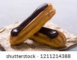 french dessert eclair with... | Shutterstock . vector #1211214388