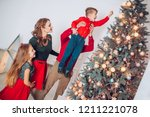 dad helping son to decorate...   Shutterstock . vector #1211221078