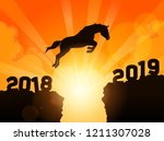 Stock vector a symbolic illustration of a silhouetted horse jumping over cliffs into next year of 1211307028