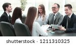 business team at a meeting in... | Shutterstock . vector #1211310325