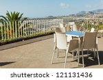 Empty cafe tables high over Funchal city and Atlantic ocean, Madeira, Portugal - stock photo