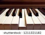 detail of a piano keyboard with ... | Shutterstock . vector #1211321182