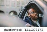 businessman wearing earphones... | Shutterstock . vector #1211373172