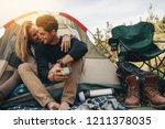 romantic couple camping... | Shutterstock . vector #1211378035