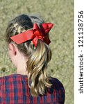 A young girl's hair pulled back into a stylish ponytail. - stock photo