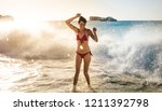 woman in bikini wearing...   Shutterstock . vector #1211392798