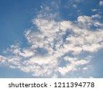 sunset and beautiful nature.... | Shutterstock . vector #1211394778
