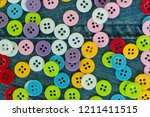 colored clothing buttons for... | Shutterstock . vector #1211411515