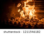 fire in the fireplace providing ... | Shutterstock . vector #1211546182