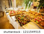 a lot of varied and delicious... | Shutterstock . vector #1211549515