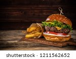 delicious hamburger with fries  ... | Shutterstock . vector #1211562652
