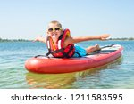 Boy Swimming On Stand Up Paddle ...