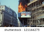 Small photo of LONDON - MARCH 31: The South African embassy in flames during the Poll Tax Riots in Trafalgar Square on March 31, 1990 in London. The protests were against the introduction of the Community Charge.
