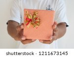 hand hold a give box | Shutterstock . vector #1211673145