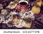fortune telling ritual with the ... | Shutterstock . vector #1211677198