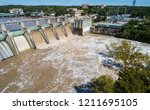 flood gates opened at... | Shutterstock . vector #1211695105