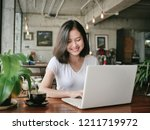 asian woman drinking coffee and ... | Shutterstock . vector #1211719972