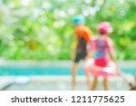 blurred children in swiimming... | Shutterstock . vector #1211775625