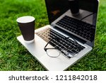 laptop with blank screen on... | Shutterstock . vector #1211842018