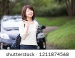 japanese lady of a middle... | Shutterstock . vector #1211874568
