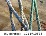 ropes on the pier in the form... | Shutterstock . vector #1211910595