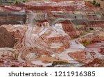 long shot of kaolin strip mine... | Shutterstock . vector #1211916385