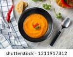 plate with tasty pumpkin cream... | Shutterstock . vector #1211917312