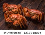 there are three hairy crabs on... | Shutterstock . vector #1211918095