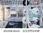 knitted fabric. textile factory ... | Shutterstock . vector #1211951458