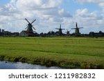 windmills in zaanse schans... | Shutterstock . vector #1211982832