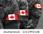 canada flags on soldiers arm.... | Shutterstock . vector #1211992138