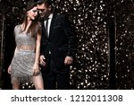 sexy couple on shine background.... | Shutterstock . vector #1212011308
