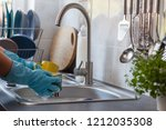washing dishes. washing the cup. | Shutterstock . vector #1212035308