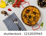 traditional paella with mussels.... | Shutterstock . vector #1212035965