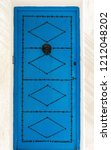 aged blue door in andalusian... | Shutterstock . vector #1212048202