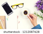 female hand with coffee cup.... | Shutterstock . vector #1212087628