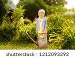 cute toddler boy in straw hat... | Shutterstock . vector #1212093292