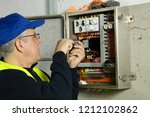 electrician at work fitting... | Shutterstock . vector #1212102862