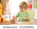 little child boy painting with... | Shutterstock . vector #1212108562