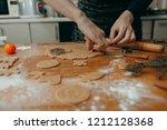 making festive gingerbread... | Shutterstock . vector #1212128368