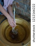 girl washing her hands under... | Shutterstock . vector #1212166222